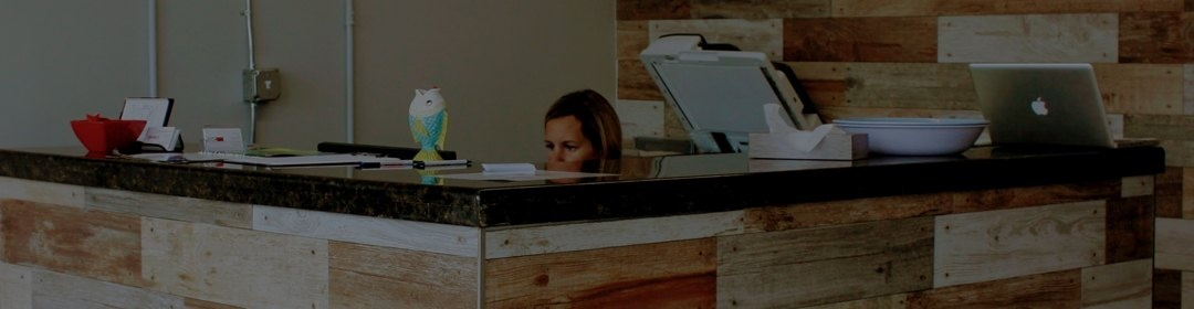 patients check in desk at chiro office