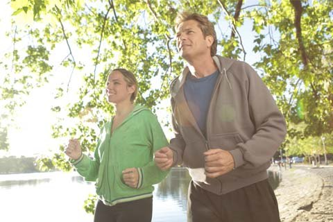 man and lady running and getting healthy